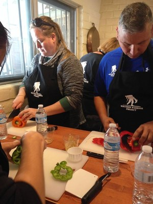 Wounded veterans learn cooking techniques during 3-day health and wellness gathering.