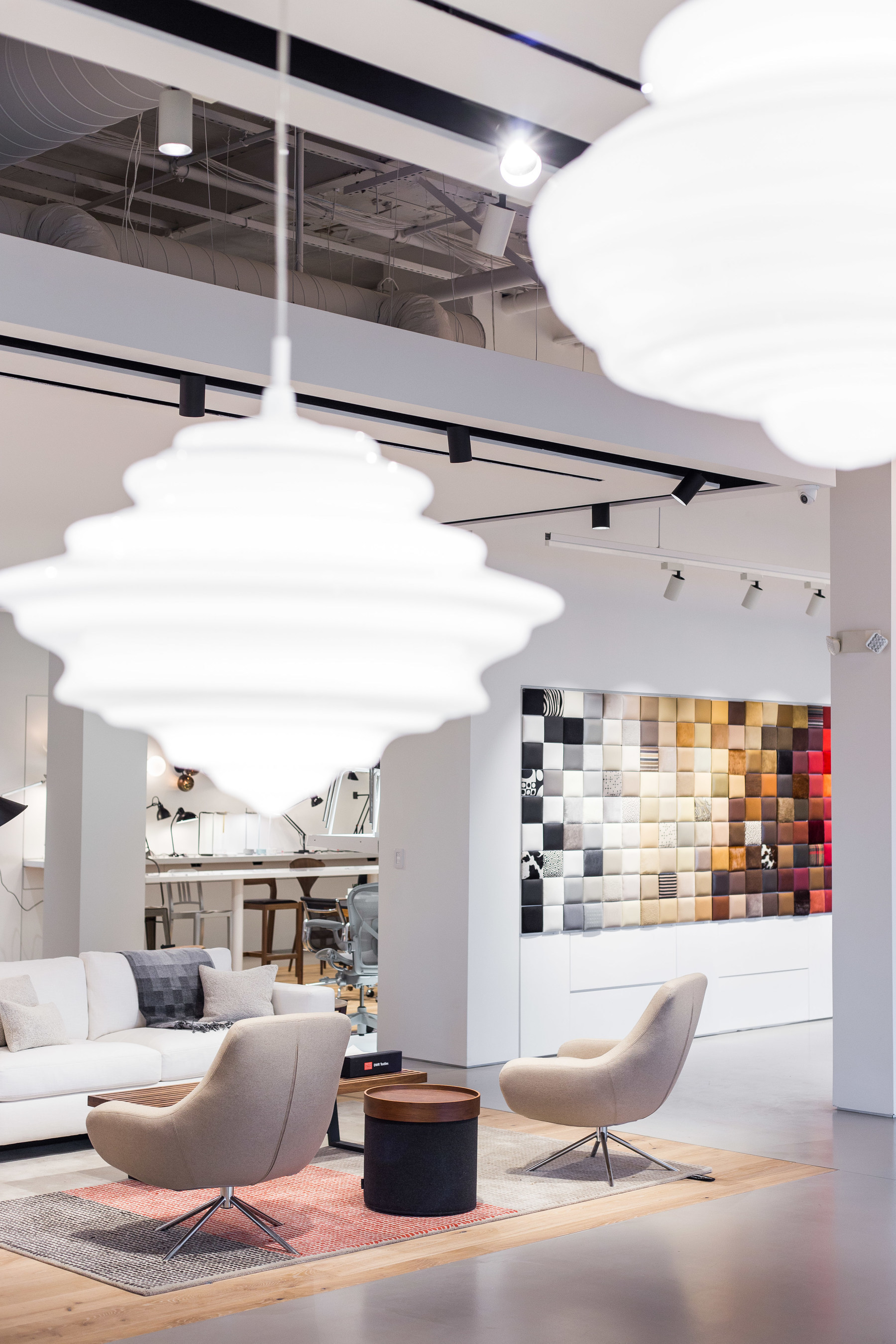 Shoppers looking to individualize their decor will love the Swatch Wall - shown in the distance - which shows off more than 300 of the thousands of upholstery options available. Photo: Alex Kusak Smith