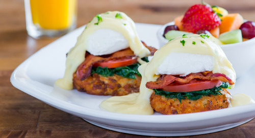 Mimi's French-Inspired Pommes Lyonnaise Benedict Places Sauteed Spinach, Sliced Tomato And Crispy Bacon Atop Potato Galettes Topped With Traditional Hollandaise Sauce. (PRNewsFoto/Mimi's Cafe)