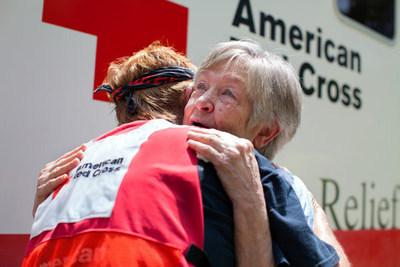 Tears fill Fonda Buckley's eyes as she gets a hug from Red Cross volunteer Cora Lee. Buckley's home was flooded in Denham Springs, Louisiana. Red Cross photo by Marko Kokic