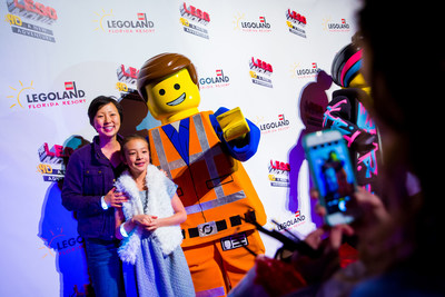 "Eight-year-old  actress  Aubrey  Anderson-Emmons,  star  of  ABC  TV's  ""Modern  Family,""  and  her  mother,  comedian,  actor  and  writer  Amy  Anderson,  pose  with  Emmet,  star  of  ""The  LEGO(R)  Movie(TM)  4D  A  New  Adventure,""  Jan.  28  at  LEGOLAND(R)  Florida  Resort  in  Winter  Haven,  Fla.  Celebrities,  media  and  VIPs  turned  out  at  the  theme  park  built  for  kids  during  a  red  carpet  gala  celebrating  the  world  premiere  of  the  brand-new  attraction,  which  combines  3D  computer  animation,  ""4D""  effects  such  as  wind,  water  and  fog,  and  the  same  sly  humor  that  made  the  movie  a  worldwide  blockbuster."