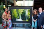 "Cirque du Soleil performers join Mike Hill (LIK USA) and Kathy Franklin (Charitybuzz) in showing off Peter Lik's ""Allure"" at Hyde Bellagio for One Night for One Drop.  (PRNewsFoto/LIK USA)"