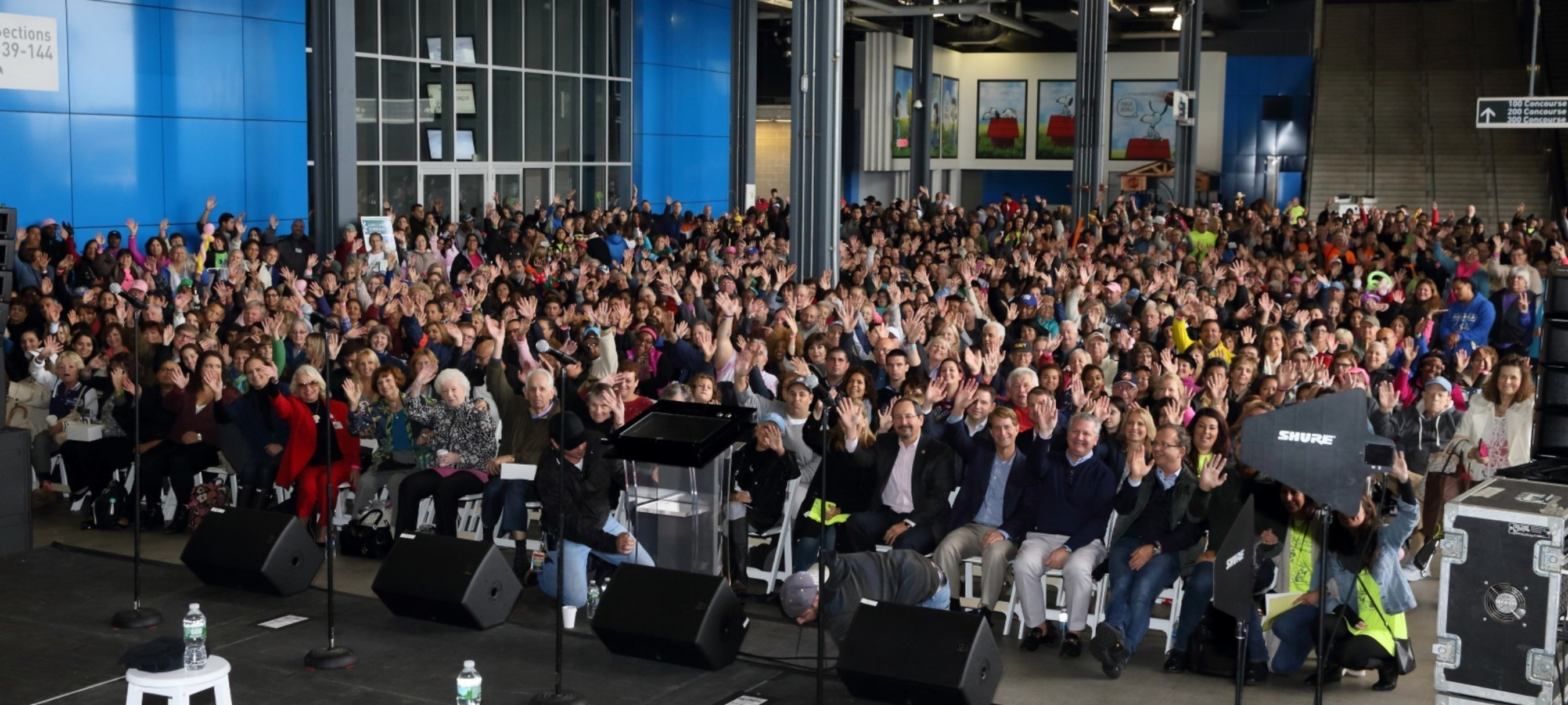 The crowd gets ready for the Midtown Men to perform. The concert and festivities were moved inside at MetLife Stadium due to the rain.