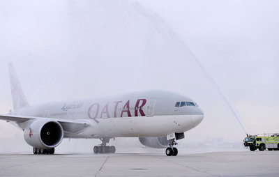A traditional water salute welcomes Qatar Airways' inaugural flight at the Philadelphia International Airport on Wednesday, April 2, 2014, in Philadelphia. Qatar Airways is the first new international airline to introduce service to and from PHL in over a decade. (Michael Perez/AP Images for Qatar Airways). (PRNewsFoto/Qatar Airways, Michael Perez/AP Images) (PRNewsFoto/QATAR AIRWAYS)