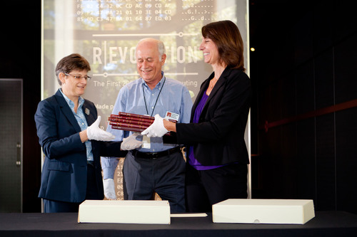 Left to right are Paula Jabloner, Director of Collections for Computer History Museum who is accepting the notebooks, David Laws, Semiconductor Curator for the Computer History Museum, and Joan Scott, Director of Community Relations for Texas Instruments in Silicon Valley handing over the Fairchild notebooks.  (PRNewsFoto/Texas Instruments)