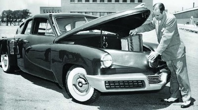 Automotive manufacturing legend Preston Tucker with one of his original Tucker 48 automobiles. (PRNewsFoto/AACA Museum Inc.)
