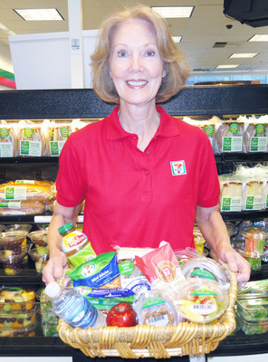 7-Eleven, Inc. dietician Patsy Ross shows a basketful of food and beverages at 7-Eleven stores for customers who want to stick to their healthier-eating resolutions but still want quick-stop convenience. Photo: courtesy 7-Eleven, Inc.  (PRNewsFoto/7-Eleven, Inc.)