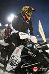 Brett Turcotte on a Trend Micro sponsored snowmobile
