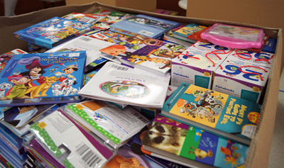 Give kids in need a truckload of 40,000 brand-new books this holiday season.  (PRNewsFoto/First Book, Gina Rullo)