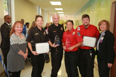 Members of Cypress Creek EMS receive the EMS Code STEMI and the Khurana EMS Stroke awards from Houston Methodist Willowbrook Hospital executives during National EMS Week.