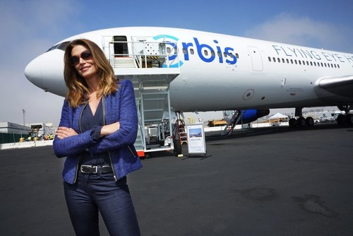 Omega Brand Ambassador Cindy Crawford, joined Orbis to help unveil its new Flying Eye Hospital at Los Angeles International Airport (C)GeoffBugbee/Orbis (PRNewsFoto/Orbis UK)