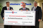 Richard Ehst (Center), President & Chief Operating Officer for Customers Bank and Timothy Romig (Right), Executive Vice President & Chief Lending Officer for Customers Bank present a $100,000 check to Kevin Murphy (Left) President of the Berks County Community Foundation to help fund educational scholarships that help eligible students get the opportunity for a better education.  (PRNewsFoto/Customers Bank)