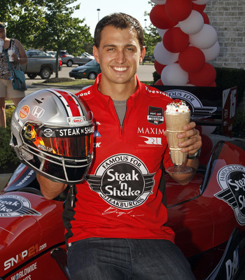 Graham Rahal, driver of the No. 15 Steak 'n Shake IndyCar, shows a specially designed Ohio State University-themed racing helmet he wore during the Indy 200 at Mid-Ohio this past weekend. He also holds The Graham Rahal Milkshake. Steak 'n Shake will donate $1 from each Graham Rahal Milkshake sold in the state of Ohio through August 31 to The Graham Rahal Foundation. The money raised will then be used to benefit FightSMA, a non-profit spinal muscular atrophy organization raising public awareness and funds for research.