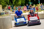 """Layla Popoff, 10, of Orlando, Fla., zoomed to victory Monday, June 20, 2016, in the """"MINILAND 400"""" race against veteran NASCAR driver Casey Mears at LEGOLAND Florida Resort. The special event #BuiltForKids celebrated the giant new Daytona International Speedway model at the Winter Haven, Fla., theme park."""