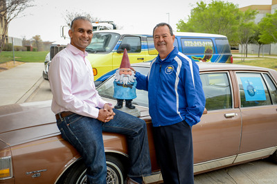 Roshan Mendis, president of Travelocity North America and Richard Marquez, president and CEO of Texans Can Academies, with the Roaming Gnome and the donated 1987 Chevrolet Caprice Classic.  (PRNewsFoto/Texans Can Academies)