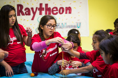 A team of girls builds a structure with spaghetti at the Los Angeles Harbor Boys & Girls Club. The activity was an exercise in civil engineering, and it was part of Raytheon's program for Girl Day 2015, a National Engineers Week event that encourages girls to discover the field and study science, technology, engineering and math.