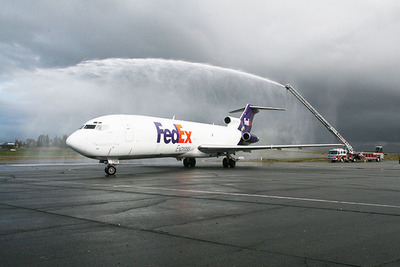 The Riverside (CA) Fire Department provides a water arch for the arrival of the Boeing 727-200 that FedEx Express donated to California Baptist University for the school's new aviation science program. The arch represented a symbolic salute on the conclusion of more than 32 years of commercial aviation service by the newly retired aircraft. (PRNewsFoto/California Baptist University, Kathie Chute)