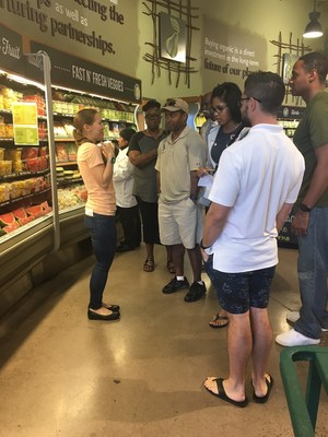 Wounded veterans tour a Whole Foods and ask questions about their dietary habits, during a recent nutrition course hosted by Wounded Warrior Project.