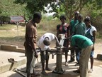 A local repair committee in the Greater Afram Plains region of Ghana fix a well provided by World Vision. (PRNewsFoto/World Vision)