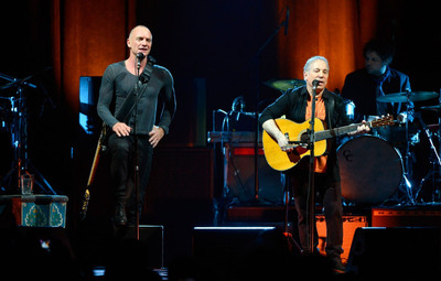 """Paul Simon and Sting kicked off their """"Paul Simon & Sting: On Stage Together"""" Tour at the Toyota Center in Houston on Saturday Feb. 8, 2014. For only 21 shows, two of music's most iconic singers/songwriters blend their voices for many of their best-known songs, weaving through and exploring each other's illustrious songbooks, performing together and individual sets with their respective bands. (PRNewsFoto/Live Nation) (PRNewsFoto/LIVE NATION)"""