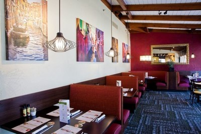 Olive Garden's new remodel design is more open and vibrant, while still maintaining the restaurant's casual warmth and family-friendly atmosphere. (PRNewsFoto/Olive Garden)