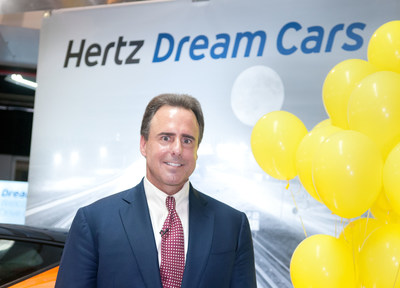 Mark Frissora, Hertz Chairman & CEO celebrates the 25,000th Dream Cars rental on Wednesday, Sept. 3, 2014 in Miami. (Mitchell Zachs/AP Images for Hertz)