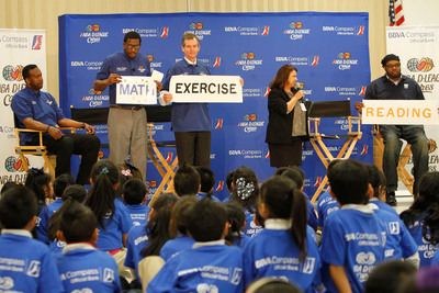 NBA Legend and Dallas Mavericks Director of Basketball Development Rolando Blackman, NBA legend Felipe Lopez, BBVA Compass Dallas City President Key Coker, Peeler Elementary Principal Helen Lopez and NBA legend Sam Perkins stress the importance of math, reading and fitness to Peeler students during the March 6 NBA D-League Cares event in Dallas.  (PRNewsFoto/BBVA Compass)