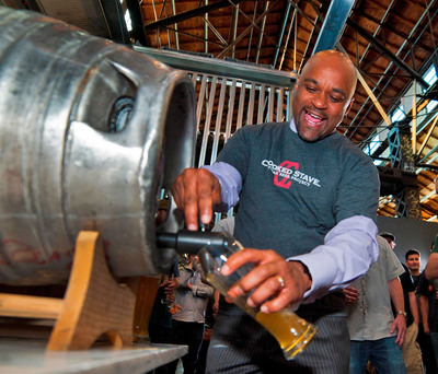 Denver Mayor Michael B. Hancock tapped a firkin at Crooked Stave Artisan Beer Project to celebrate the start of Denver Beer Fest 2013, a celebration of The Mile High City's beer culture featuring more than 300 beer-related events taking place from Oct. 4-12. DenverBeerFest.com.  (PRNewsFoto/VISIT DENVER, The Convention & Visitors Bureau)