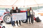 Mahindra executives Rick Haas and Cleo Franklin (left) present one of the company's five urban agriculture grants to Keep Growing Detroit's Ashley Atkinson and Willie Spivey (right).