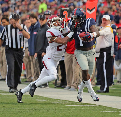 Ole Miss wide receiver Laquon Treadwell eludes an Arkansas defender in a Nov. 7 SEC game at Vaught-Hemingway Stadium in Oxford, Mississippi.  Treadwell, a semifinalist for the Biletnikoff Award as the nation's top receiver, and Mississippi State quarterback Dak Prescott, a Heisman Trophy candidate, lead a list of 10 nominees for the 2015 C Spire Conerly Trophy, which annually honors the top college football player in the Magnolia State (photos credit Ole Miss and Mississippi State Athletics)