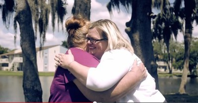 Amelia Lucas shares a moment with Laura Gannon, a Staywell Health Plan social worker who helped Amelia get the medical supports and services she needed to care for her injured son at home.