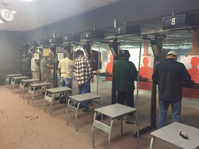 Wounded veterans come together at indoor shooting range.