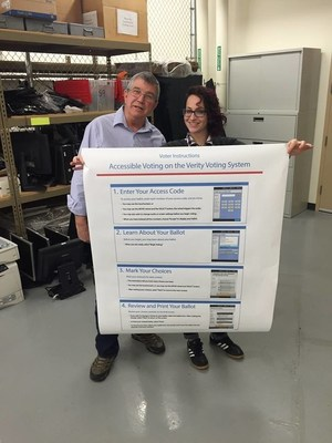 Gregg Long and Micki Love, election specialists in the Ada County office, share life-size instructions about accessible voting on the Verity system.