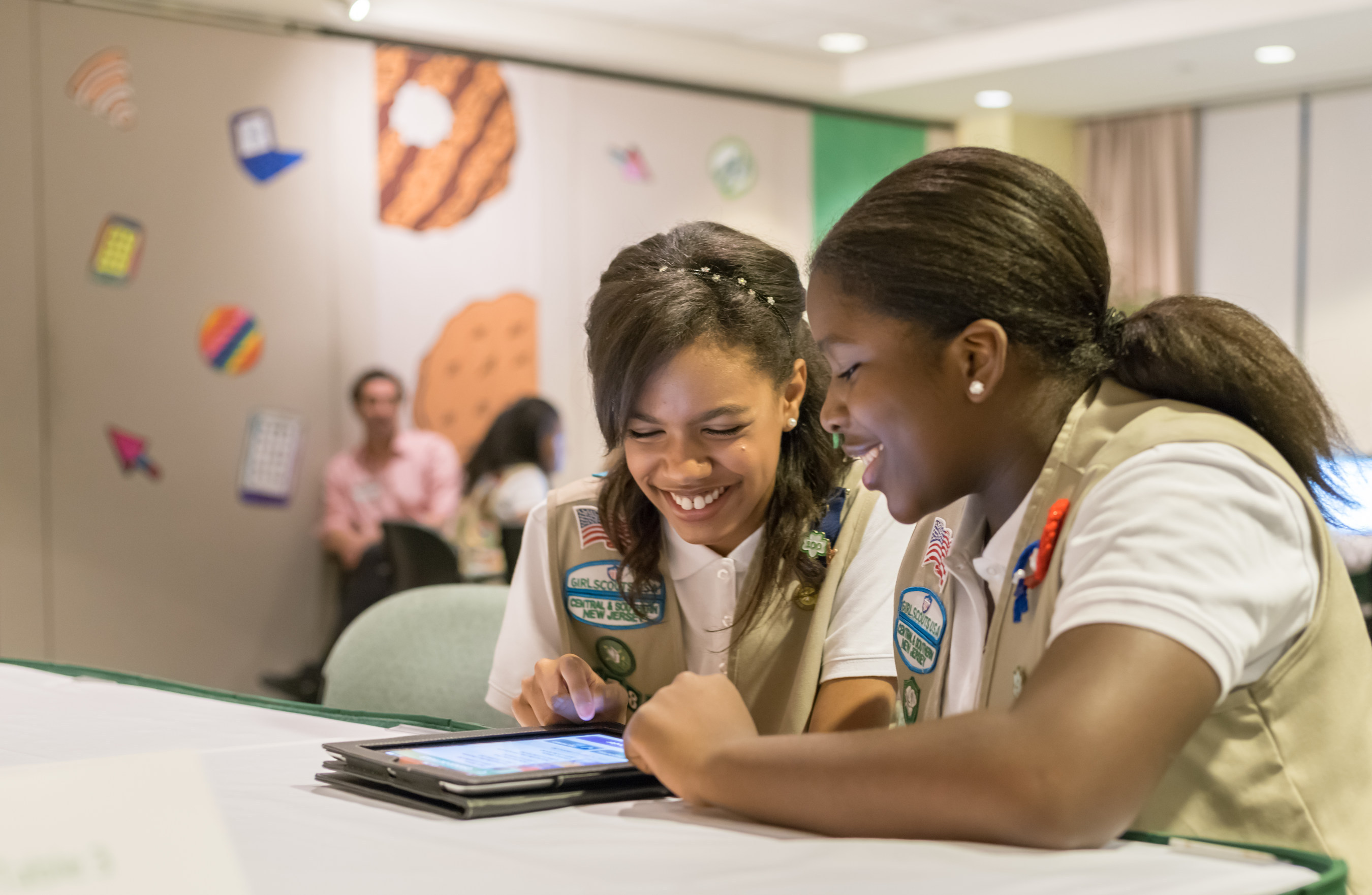Bria and Shirell practice placing orders with Digital Cookie, a new addition to the Girl Scout Cookie Program.