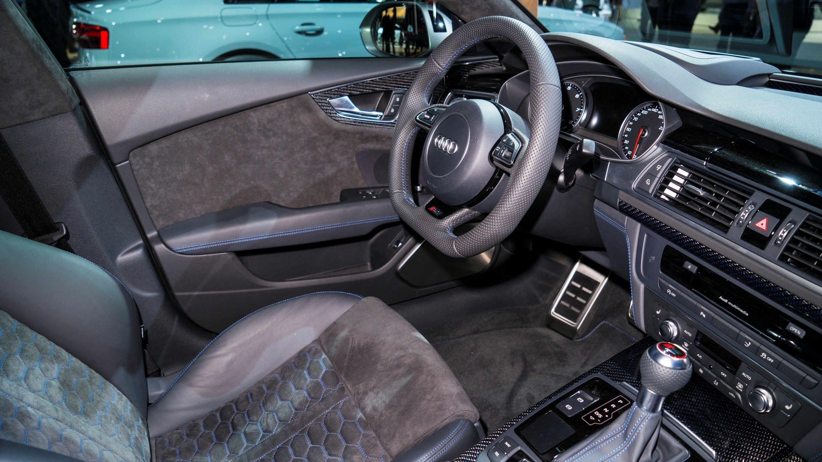 Audi RS-7 sports Alcantara in a honeycomb pattern on the seats and complementary Alcantara on the door panels.