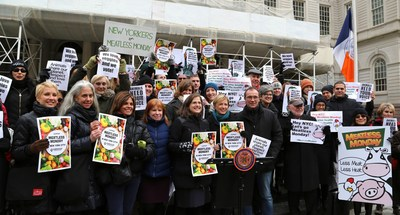 A diverse group of New Yorkers, led by New York City Council member Helen Rosenthal (with glasses, in front of podium), rally at the steps of City Hall, to support Meatless Monday resolution.