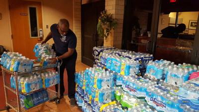 Rev. Sellars Vines, Joseph Assignment Volunteer Receives Water Donations from Community