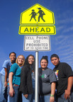 Texas law bans cell phone use in school zones, but only where a state-approved sign is in place. Springlake-Earth High School student leaders in Earth, Texas, secured the signs and will unveil them this week.  (PRNewsFoto/National Youth Leadership Council)