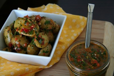 Latino Foodie's Red Chimichurri Idaho(R) Potato Salad creatively uses chimichurri sauce, often served as an accompaniment to grilled meat in Argentina, to enhance the earthy flavor of Baby Dutch Yellow Idaho(R) Potatoes.