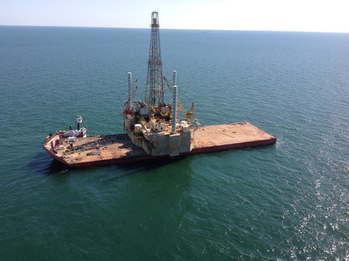 Inland Salvage Successfully Delivers Salvaged Jack-up Drill Rig which sank last winter in the Gulf of Mexico.  (PRNewsFoto/Inland Salvage Inc.)