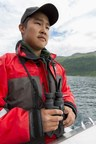 Alaska Native Science & Engineering Program student and native of the small Alaska village of Tuntutuliak, Randall Friendly searches for Kodiak brown bears along the shore while studying the elusive species during his Summer Bridge internship. (PRNewsFoto/Alaska Native Science and...)