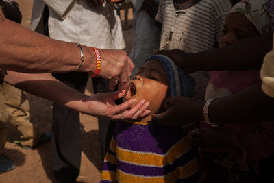 Drops of the oral polio vaccine are given to a child in Nigeria. Photo Credit: Ruth McDowall for Rotary International