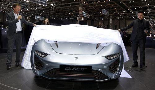 World premiere: The new QUANT e-Sportlimousine of the nanoFLOWCELL AG at the Geneva Motor Show 2014 with Nunzio La Vecchia (right) and Wolfgang Rother (left) (PRNewsFoto/nanoFLOWCELL AG)