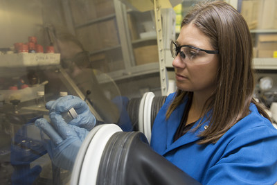 IBM scientist, Jeannette Garcia, Ph.D., examines purified, non-toxic plastic created from recycled smartphones and CDs.