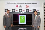 Celebrating the LG 55-inch Curved OLED TV as the world's first TV to achieve UL Environment's rigorous GREENGUARD certification for low emissions are (left to right) Carlos Correia, Global Vice President, UL Environment, and Thomas Lee, Senior Vice President, Home Entertainment, LG Electronics USA. (PRNewsFoto/LG Electronics USA, Inc.)