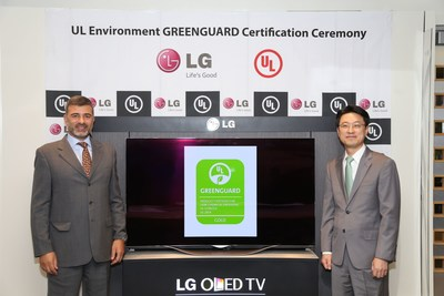 Celebrating the LG 55-inch Curved OLED TV as the worlds first TV to achieve UL Environments rigorous GREENGUARD certification for low emissions are (left to right) Carlos Correia, Global Vice President, UL Environment, and Thomas Lee, Senior Vice President, Home Entertainment, LG Electronics USA.