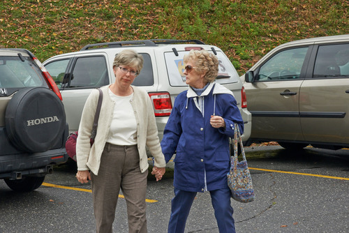 """Philadelphia nurse Barbara Mancini holds hands with her mother Marge Yourshaw as they walk into a Oct. 10 hearing in Pottsiville, Pa. on a motion to dismiss unjust """"assisted suicide"""" case against Mancini for death of terminally ill, 93 year-old father Joe Yourshaw. (PRNewsFoto/Compassion & Choices) (PRNewsFoto/COMPASSION & CHOICES)"""