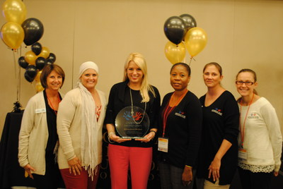 The Monique Burr Foundation staff gathers with Florida Attorney General Pam Bondi, center, after awarding her the inaugural Champions for Child Safety Award at the Florida School Counselor Association Convention. From l to r, Lynn Layton, Stacy Pendarvis, Florida Attorney General Pam Bondi, Antionette Meeks, Cori Wilson, and Cierra Bennett congratulate and thank AG Bondi for her support of the Foundation's mission because Child Safety Matters.