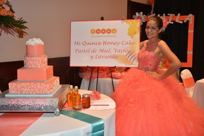 "Austin quinceanera Twila R. with her stunning honey-based cake ""Quince Honey Cake"", presented by The National Honey Board. Photo courtesy: The National Honey Board"