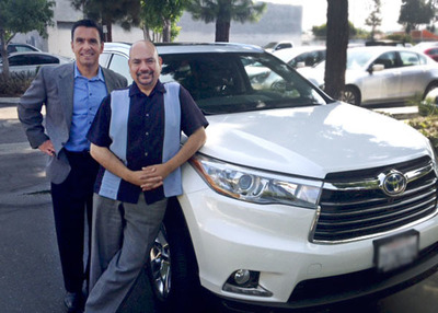 Anthony Salcido (left), vice president of Toyota Motor Sales, Inc., delivers the 2014 Highlander Hybrid to Arturo Vargas (right), executive director of NALEO Educational Fund.  The Highlander Hybrid is the official car of the NALEO 31st Annual Conference, to be held June 26-28, 2014, in San Diego, Calif.